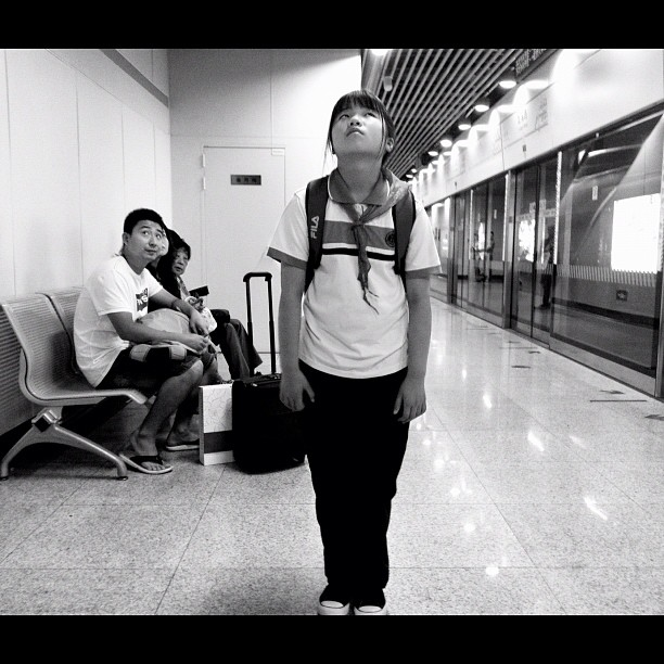 Watching the national news               by Godo Chillida blackandwhite, bw, china, girl, igersbarcelona, iphoneography, monochrome, news, passengers, shanghai, streetphotography, streetphoto_bw, subway, ubiquography,