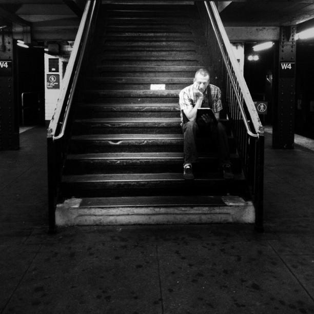 The reader. NYC subway by Carolina de Britos blackandwhite, bw, ilovebooks, nyc, passengers, reader, stairsnyc, streetphotography, sushidetortilla, sushiinnewyork, undergroundnyc,