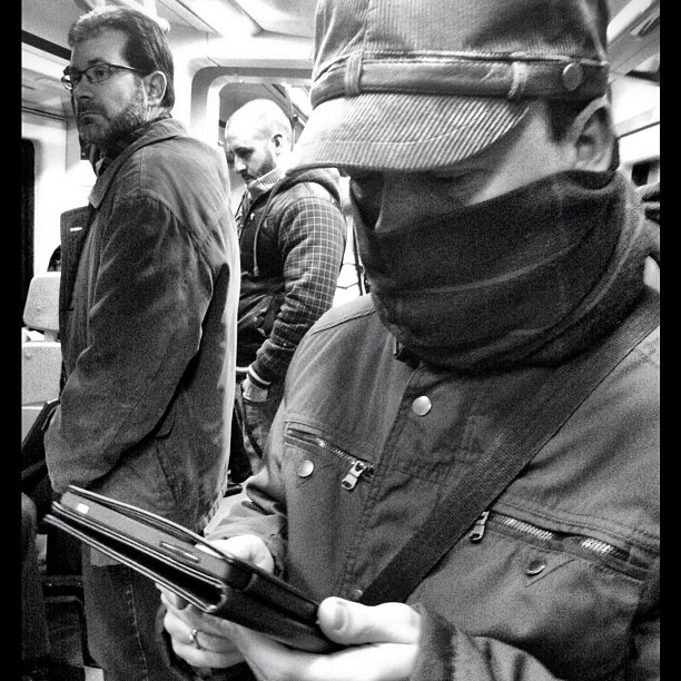 Reading in the cold winter by Vicente Jurado igersmadrid, passengers, simplybnw, street,