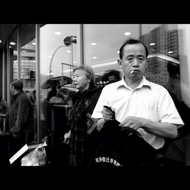 Hard man             by Godo Chillida blackandwhite, busstation, china, igersbarcelona, man, monochome, passengers, shanghai, smoking, streetphotography, streetphoto_bw, ubiquography,