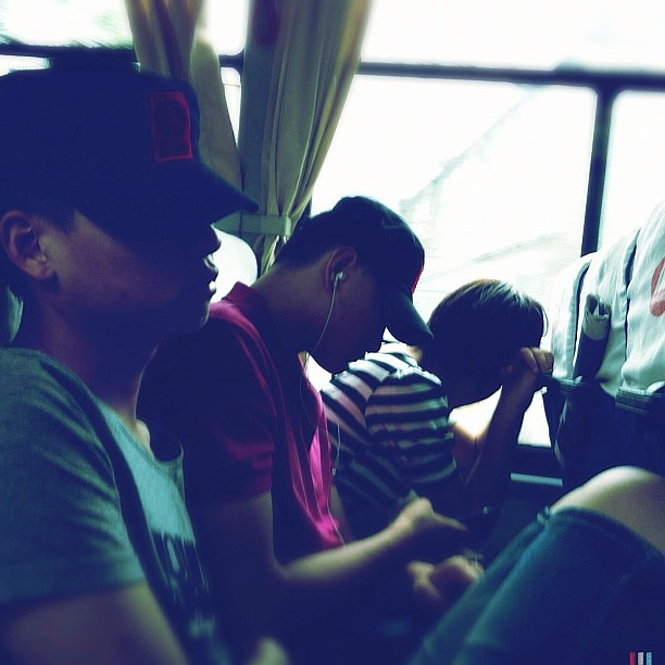 Everybody is sleeping. Returning to Beijing from the great wall               by Godo Chillida beijing, bus, cap, china, color, greatwall, guys, hipstamatic, igersbarcelona, iphoneography, mao, passengers, streetphotography, streetphoto_color, ubiquography,