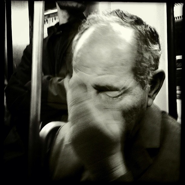 The subway is a good place to cry by daily miseries. Nobody notices, especially if you are an immigrant.                  by Godo Chillida barcelona, blackandwhite, bw, crying, igersbarcelona, inmigration, iphoneography, man, monochrome, passengers, realsuperhero, sadness, social, streetphotography, streetphoto_bw, subway, ubiquography,