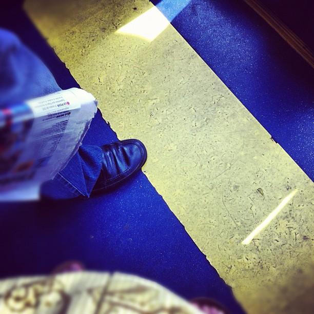 Listo para cruzar la línea    by Núria Rodríguez bus, feet, passengers,