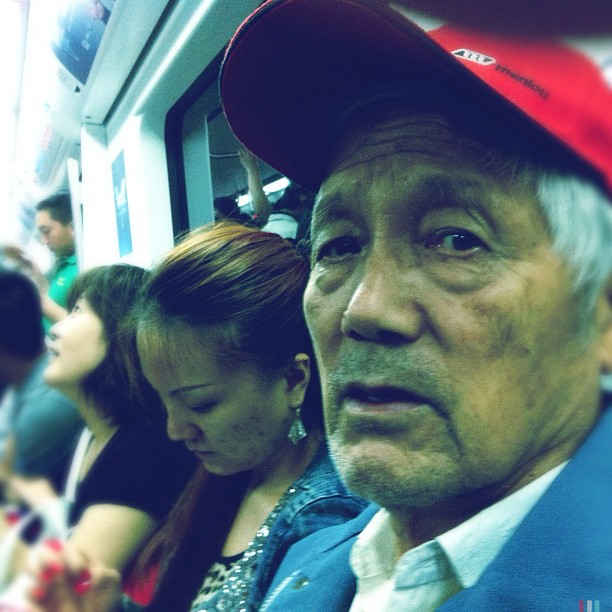 Retired beisball player              by Godo Chillida beijing, beisball, china, color, igersbarcelona, iphoneography, man, passengers, retired, streetphotography, streetphoto_color, subway, ubiquography,