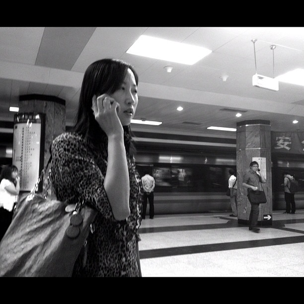 Hello, where are you? Hello, just turn left your head.               by Godo Chillida beijing, blackandwhite, bw, china, communication, couple, igersbarcelona, iphoneography, monochome, passengers, streetphotography, streetphoto_bw, subway, ubiquography,