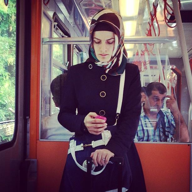 Texting  by Fran Simó passengers,