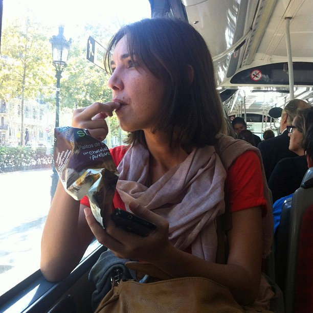 Eating on the bus.             by Benjamín Julve bcn, igers, iphonesia, passengers, photooftheday, statisgram, street, streetphotography, transport, ubiquography, webstagram,