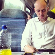I don't know what he's drinking but it looks like piss     by southcoasting bottle, passengers, train, whiteshirt,