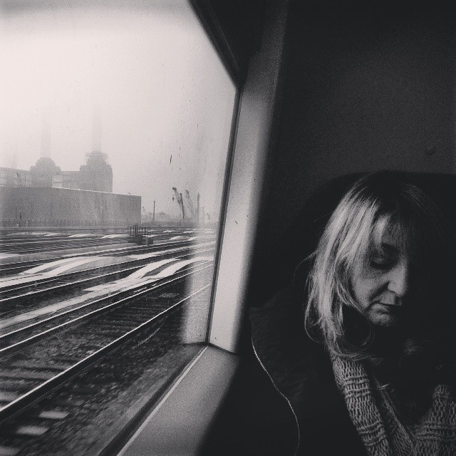 On the train passing Battersea Power Station       by southcoasting blackandwhite, black_and_white, icons, london, passengers, peopleonpublictransport,