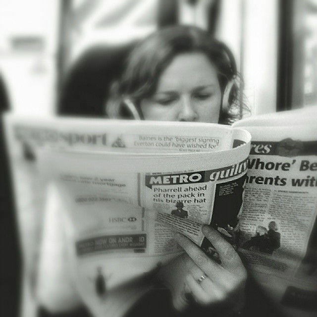 Surprised by the news      Harsh headline deserves the two fingers by southcoasting newspaper, passengers, reader, reading, train,