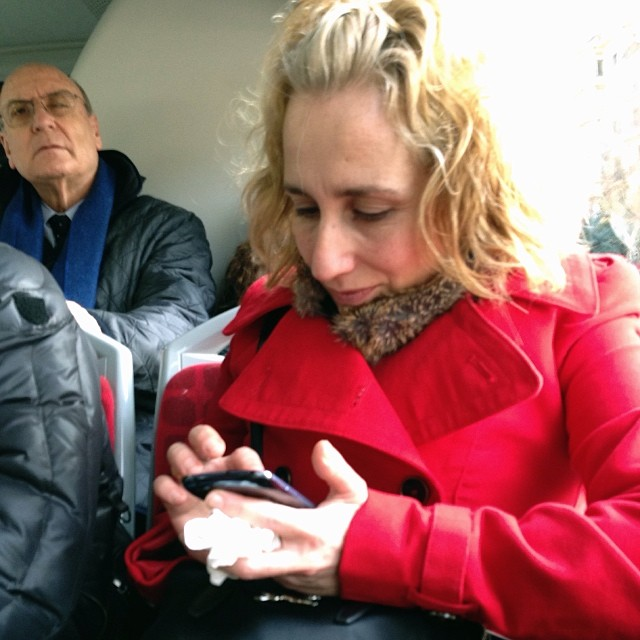 Red texting  by Paula Jarrin barcelona, bus, igerbcn, igerscatalunya, instagramers, iphoneonly, iphonesia, passengers, snapseed, streetphotography, ubiquography,