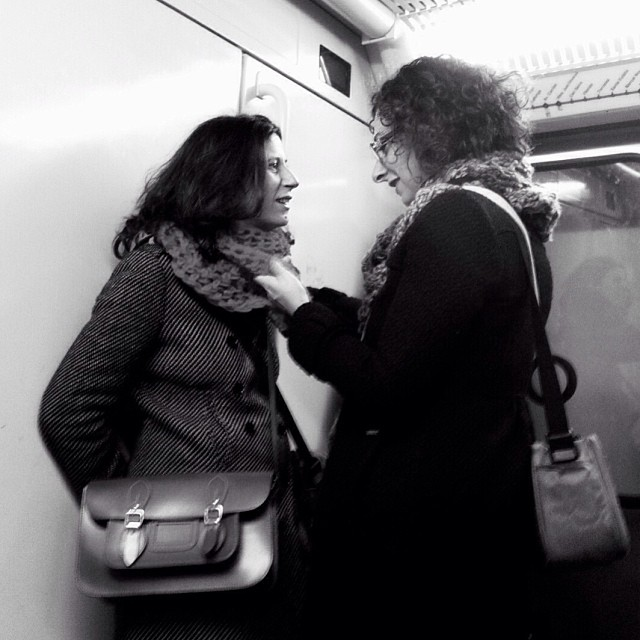 The importance of a small gesture at the right time by Godo Chillida blackandwhite, bws_worldwide, couple, monochrome, passengers, streetbw, streetphoto, streetphotography, subway, subwaypeople,