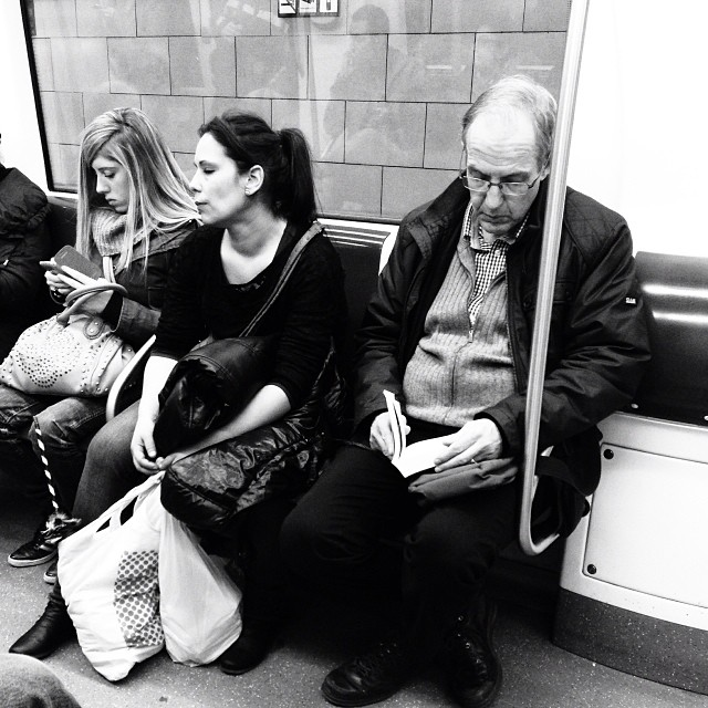 Texting, waiting and reading  by Paula Jarrin barcelona, bw_lovers, igerbcn, igerscatalunya, metro, passengers, snapseed, subway, ubiquography,