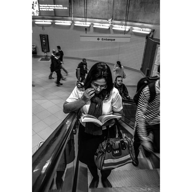Reading at the escalator.... lendo na escada rolante.... by Paulo Wang amigersbr, ampt_community, blacknwhite_perfection, bnw_life, brasilpb, bws_artist_latin, bws_worldwide, chiquesnourtemo, galeriamink, ic_bw, ic_streetlife, iglightshots, insta_pick_bw, jornalistasdeimagens, mafia_streetlove, mono_street, my_flagrants, passengers, pix_mania, rsa_streetview, sambapix, streetbw, streetbw_streetcolour_2014_07, streetcolour, streetphotography_bw, vidanoolhar, youmustsee,
