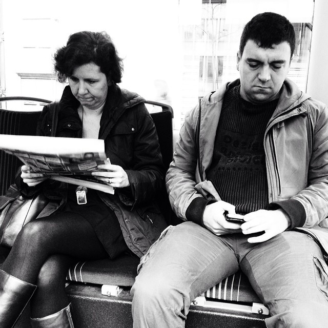 Newspaper and mobile   by Paula Jarrin passengers, readssenger,