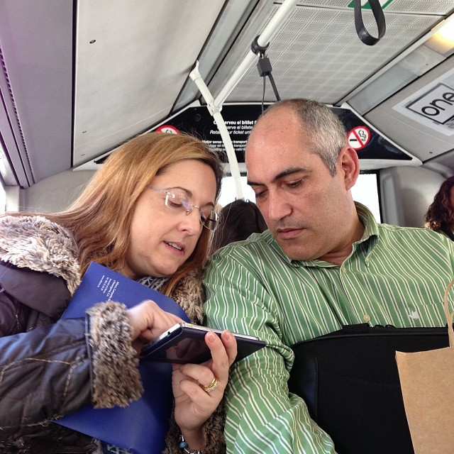 E-reading together  by Paula Jarrin passengers,