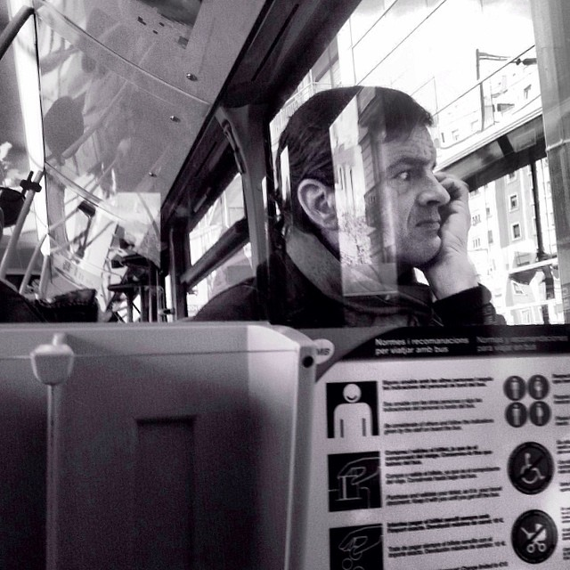 He is very concerned about how the government is destroying the social fabric by Godo Chillida barcelona, blackandwhite, bus, bws_worldwide, criticalthinking, government, monochrome, passengers, repression, resignation, social, streetbw, streetphoto, streetphotography, ubiquography,